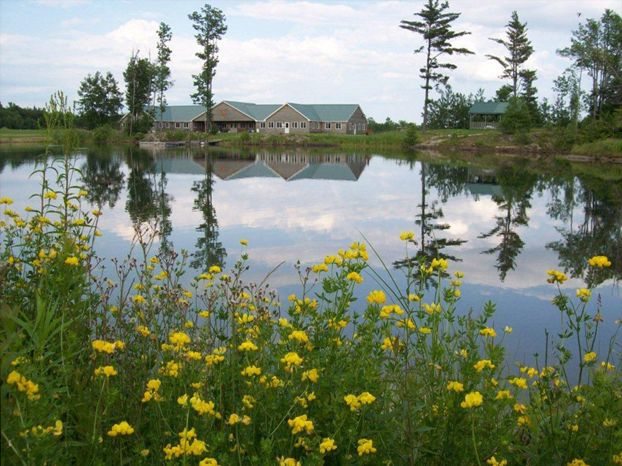 The  main lodge at Twin Ponds Lodge, looking across one of the ponds from the cabin area.